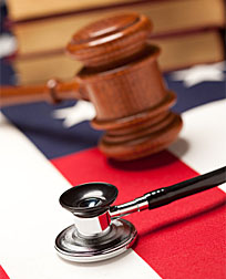 Gavel, Stethoscope and Books on the American Flag with Selective Focus.